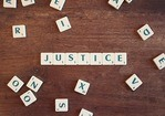 justice spelled using scrabble